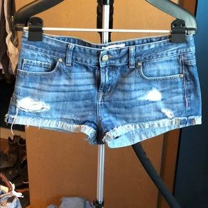 Pink brand denim shorts with tiny slits in sides